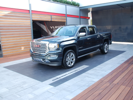 GMC highlighted its Denali trim, with emphasis on its Sierra Denali HD pickup.