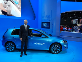 Jonathan Browning, President and CEO, Volkswagen Group of America, Inc., stands next to the...