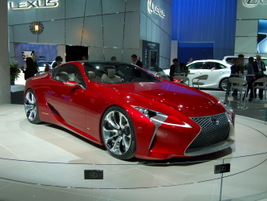 The Lexus describes its LF-LC as a hybrid sport coupe concept with a front engine and rear-wheel...