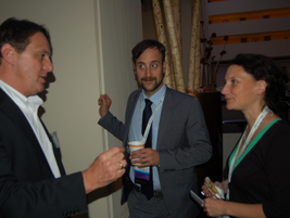 Nexus Communication's Steven Schoefs (center) and Caroline Thonnon engage in a conversation with...
