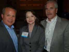 (L-R) Chrysler's Jim Sassorossi, Brenda Davis of Baker Hughes, and Terry Langness of PARS pose...
