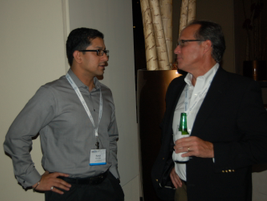 (Left) Rahul Bhardwaj of Pfizer and Jeff Nichols of Ford continued discussions about the day's...
