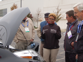 Attendees look under the hood of a Nissan LEAF.