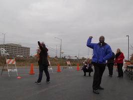 Natalie Weimer, XL Hybrids, launches an apple into the parking lot of the Ride and Drive event.