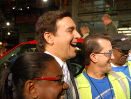 CEO Mark Fields poses with happy Ford Rouge plant employees after the roll off.