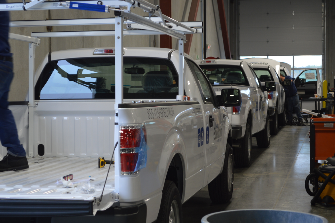These F-150 models are being upfit for Charter Communications.