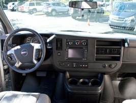 The truck-like interior for this Savana includes navigation and a rear-view camera.