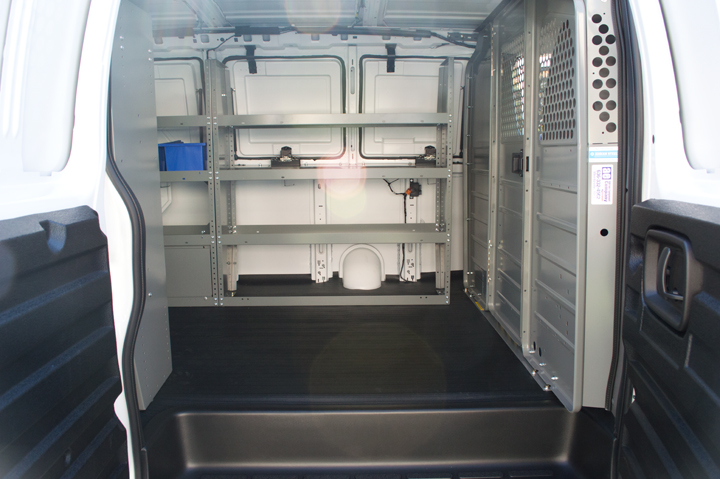 The rear cargo area can accommodate various rack-and-bin packages.