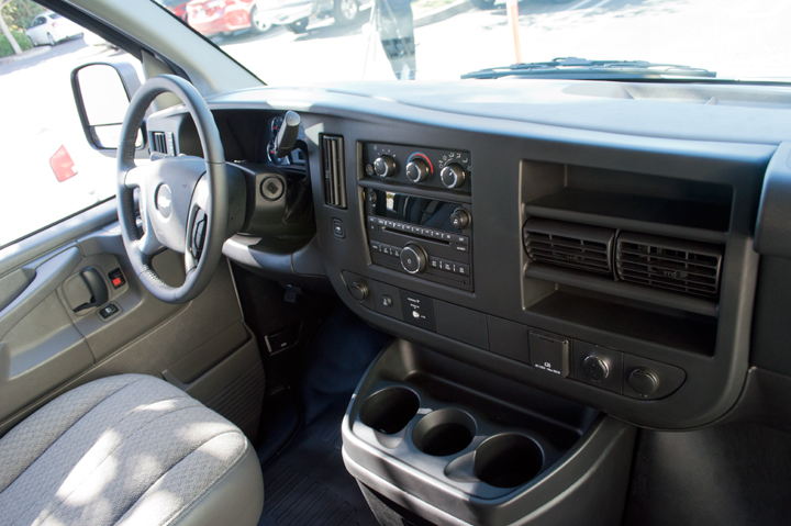 The truck-like interior includes a AM/FM radio, CD player accessible with steering-wheel controls.