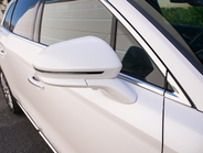 The MKX's side-view mirrors retract when the vehicle is parked.