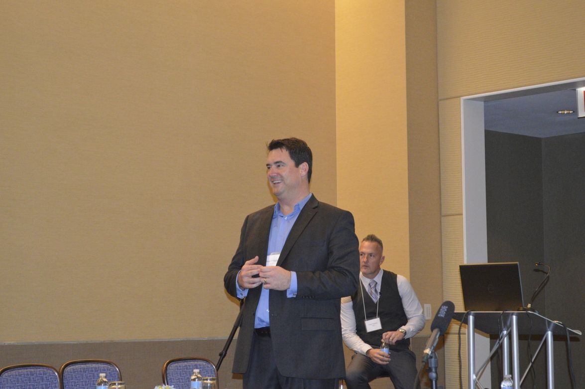 Sean O'Malley (L), CEI's Midwest regional sales manager, introduces Brian Kinniry, senior...