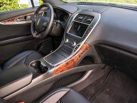 Leather seating surfaces and a leather-wrapped steering wheel place the vehicle firmly in the...