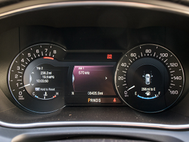 A digital driver's informational display provides trip and vehicle function data.