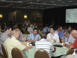 Attendees gather at the breakfast held before the event's opening keynote address.