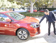 Shiro Nakamura, Nissan's senior vice president and chief creative officer, shows some of...