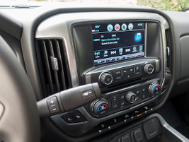 An 8-inch color touchscreen displays the MyLink infotainment system.