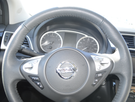 Sentra's SL offers a leather-wrapped steering wheel and leather seats.The vehiclescan be driven...