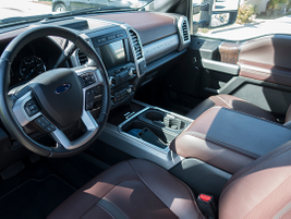 The interior offers a leather-wrapped steering wheel, particulate air filter, and adjustable...