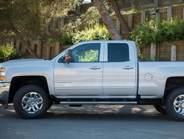 The Silverado 2500's Double Cab offers a full front door and smaller rear door with a handle...