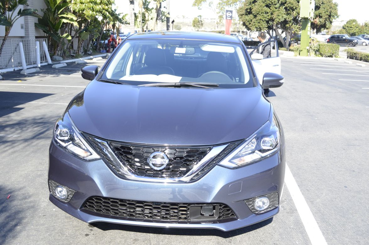 "The 2016 Nissan Sentra features a redesigned hood, front fascia and ""V-motion"" grille."