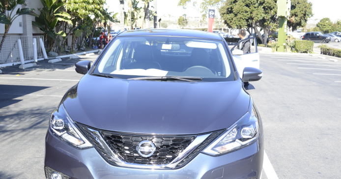 """The 2016 Nissan Sentra featuresa redesigned hood, front fascia and """"V-motion"""" grille."""