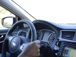The all-new LCD 5-inch flat panel (above the steering wheel) displays navigation, safety...