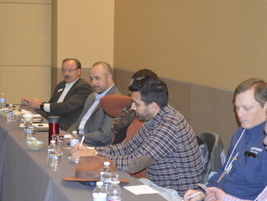 Wayne Smolda (L), CEO and president of CEI, engages with attendees during the seminar. Smolda is...