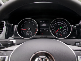 An informational display between the speedometer and tachometer shows MPG changes and other data.