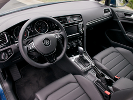 Easily identifiable steering wheel controls include cruise control and audio volume.