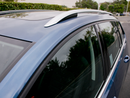 Roof rail trim accentuates the wagon-oriented styling for this compact car.