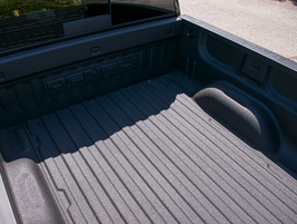 This Sierra 1500's short box (5 3/4 feet) includes a spray-on bedliner.
