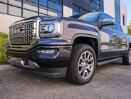 The Denali package adds a chrome grille, LED front headlights, and other upgrades.
