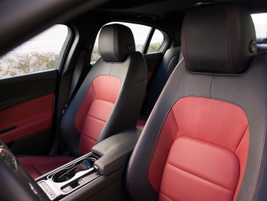 The R-Sport interior offers leather seating surfaces and an accent color.