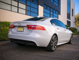 Wraparound rear taillights link the XE's design to other Jaguar models, including the XF and XJ.