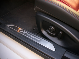 The R-Sport package adds interior details such as this badge on the rocker panel.
