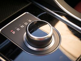 The XE's electronic shifter dial pops up when you start the car like other Jaguar models.