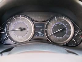 A traditional mostly non-digital gauge cluster includes a display that feeds vehicle operating data.