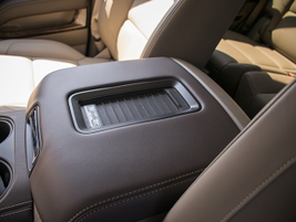 A center console mat can wirelessly charge phones that are compatible with Qi/PMA.