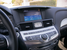 The Q70's infotainment system includes a CD player and navigation that displays on an 8-inch...