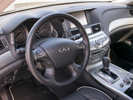 The interior includes amenities such as Japanese Ash wood trim and a heated steering wheel.