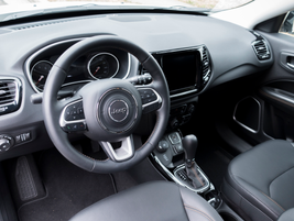 A leather-wrapped steering wheel contains a heating element.