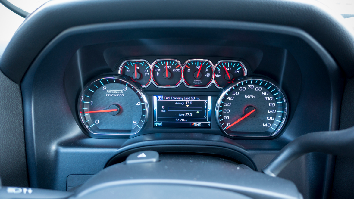 The instrument cluster display offers data on trip, fuel economy, media, and navigation.