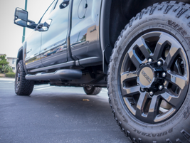 The truck rides on LT275/65R18 Goodyear Duratrac MT-rated tires fitted to 18-inch black-painted...