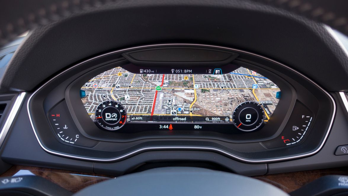 The Q5 adds the Virtual Cockpit feature that allows drivers to view a 3-D map on the instrument...