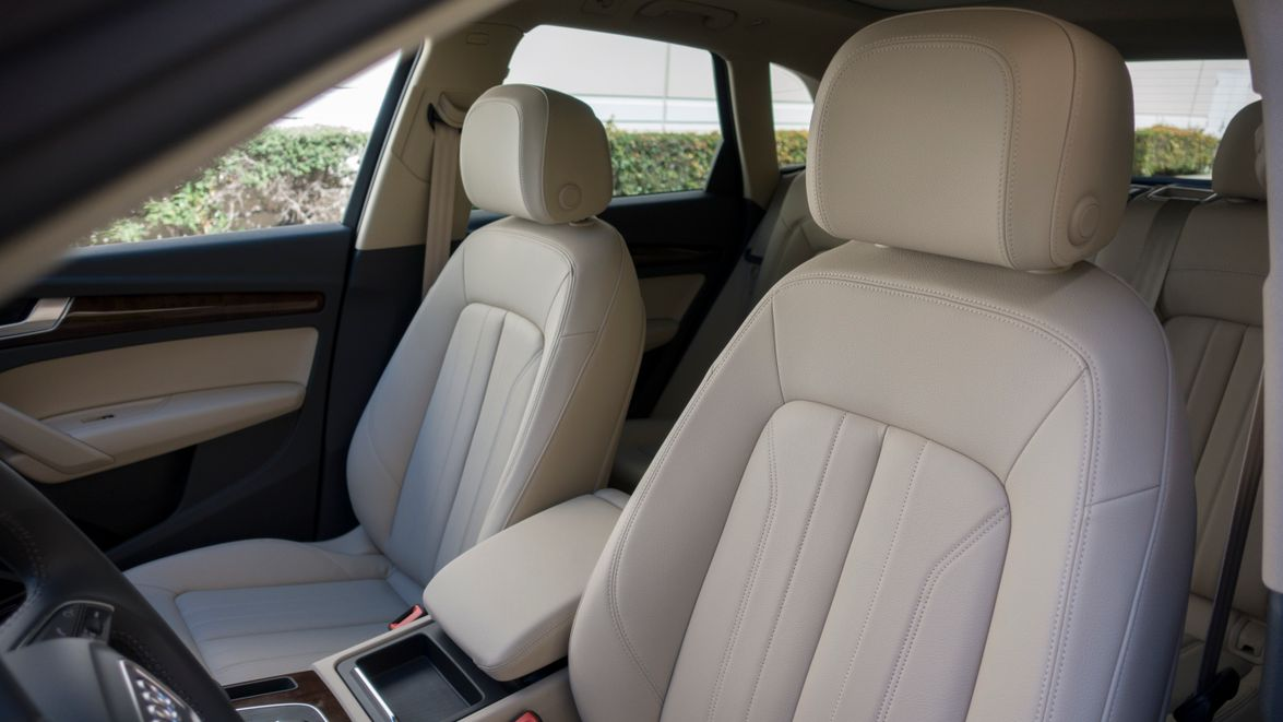Leather surfaces cover front seats.