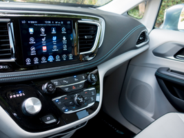 A 7-inch dashboard screen displays FCA's Uconnect system.