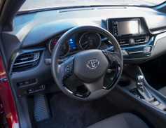 A leather-trimmed steering wheel offers controls for phone, voice, dynamic cruise control and...