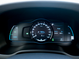 A 7-inch cluster display provides charge level, fuel level, and other operating data.