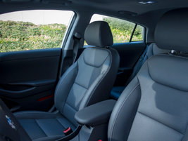 Front seats have leather seating surfaces and the driver's seat offers powered adjustment.