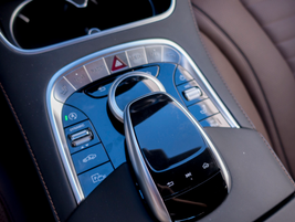 The center console features the Comand infotainment system's controller and an array of other...